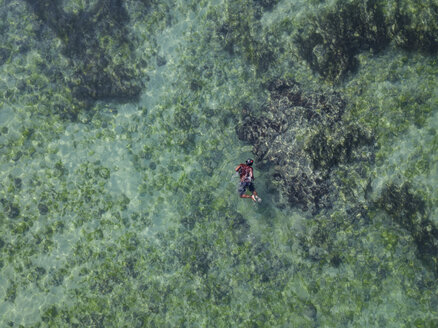 Indonesia, Bali, Aerial view of snorkeler - KNTF01654