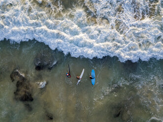Indonesia, Bali, Aerial view of Dreamland beach, three surfers from above - KNTF01742
