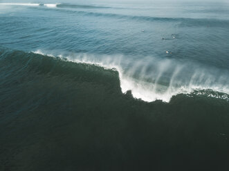 Indonesia, Bali, Aerial view of surfers, big wave - KNTF01764