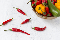 Five red chili pods and bowl of various chili peppers - JUNF01251