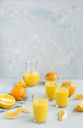 Glasses of freshly squeezed orange juice and oranges - JUNF01260