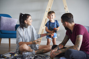 Happy modern family decorating the home for Christmas - ABIF01049