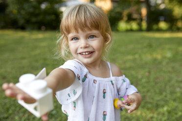 Portrait of cute little girl in garden - ZEDF01549