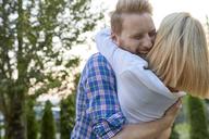 Happy couple hugging outdoors - ZEDF01558