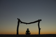 Silhouette Of A Man Meditating On A Beach In Los Barriles, Mexico - AURF05560