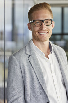 Portrait of smiling redheaded businessman wearing glasses - RBF06725