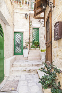 Italy, Puglia, Polognano a Mare, house entrances at historic old town - FLMF00039