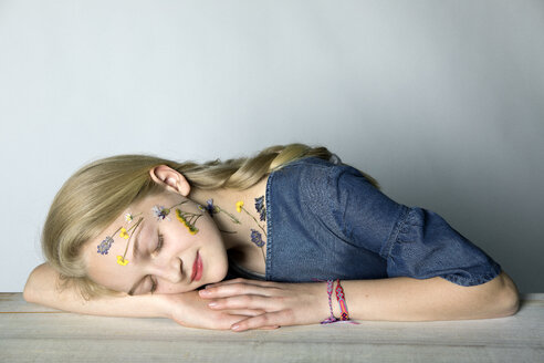Portrait of blond girl with tattoo of pressed flowers on her face - PSTF00243