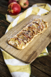 Home-baked Apple Pie on wooden board - GIOF04491