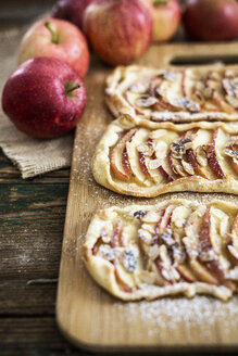 Home-baked Apple Pie on wooden board - GIOF04494