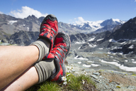 Trail running shoes are resting in the mountains of Switzerland. - AURF05642