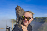 Young woman and monkey - AURF05819