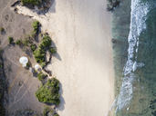 Indonesia, Bali, Aerial view of Nyang Nyang beach, Bubble tent house at the beach - KNTF01802