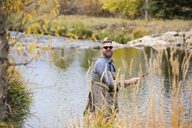 A happy fly fisherman on the river near Breckenridge, Colorado - AURF05882