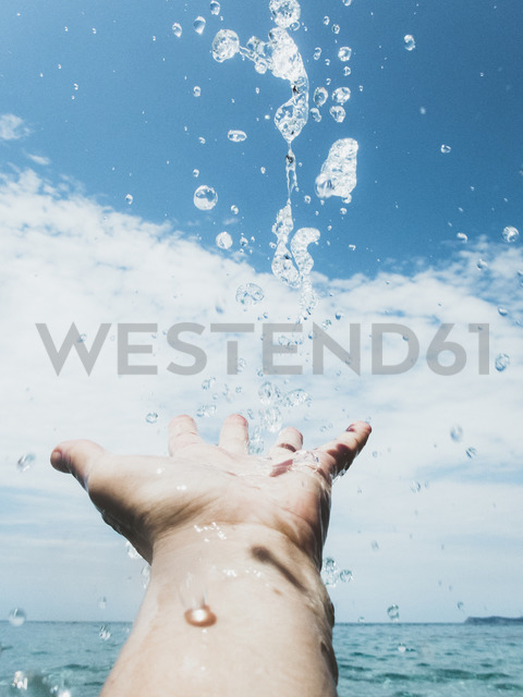 Close-up of woman's hand in the sea and water drops - PSIF00081