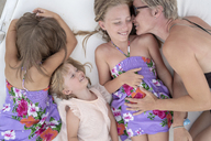 Happy woman cuddling with three girls - PSIF00108