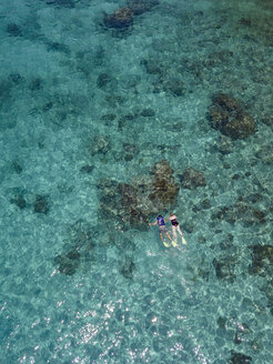 Indonesia, Bali, Aerial view of Blue Lagoon beach, snorkelers - KNTF01807