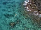 Indonesia, Bali, Aerial view of Blue Lagoon, snorkeler - KNTF01810