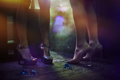 Legs of young women at nightclub - LUXF00389