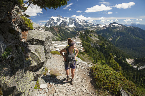 Female hiker walking on mountain at North Cascades National Park - CAVF48876