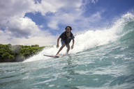 Low angle view of man surfing on sea against sky - CAVF48909