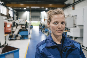 Young woman working as a skilled worker in a high tech company, portrait - KNSF04859