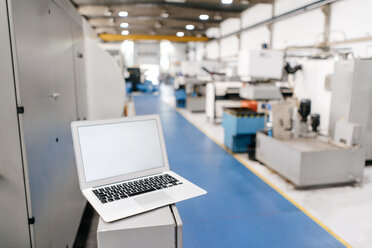 Laptop with blank screen in factory workshop - KNSF04922