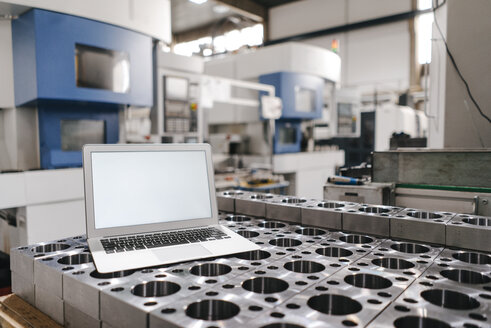 Laptop with blank screen in factory workshop - KNSF04925