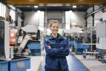 Young woman working as a skilled worker in a high tech company, portrait - KNSF04946