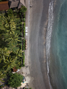Indonesia, Bali, Aerial view of beach with empty sun loungers - KNTF01872
