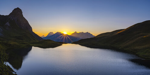 Germany, Bavaria, Allgaeu, Allgaeu Alps, Lake Rappensee, Kleiner Rappenkopf at sunset - WGF01254