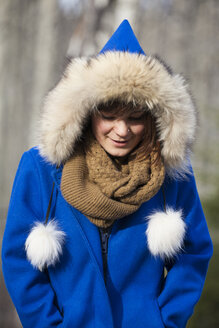 Portrait of a young woman dressed in a warm winter jacket. - AURF06676