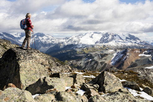 Female hiker looking at view of Garibaldi Provincial Park from top of Whistler Mountain, Whistler, British Columbia, Canada - AURF06823