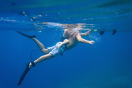 Father and son diving under water,Bali,Indonesia - AURF06895
