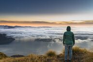 New Zealand, South Island, Wanaka, Otago, woman on Coromandel peak at sunrise - MKFF00408
