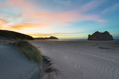 New Zealand, South Island, Puponga, Wharariki Beach at sunset - MKFF00429