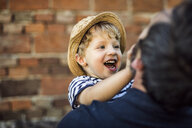 Portrait of laughing toddler having fun with his father - HAPF02722
