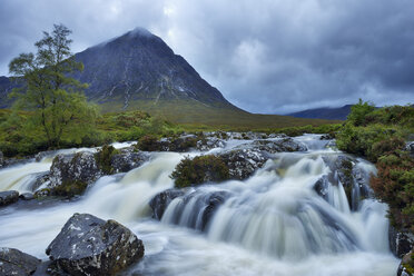 United Kingdom, Scotland, Glencoe, Highlands, Glen Coe, Coupall Falls of River Coupall with mountain Buachaille Etive Mor in background - RUEF01995
