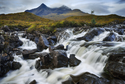 United Kingdom, Scotland, Scottish Highlands, Isle Of Skye, Waterfall at Sligachan river with view to the Cuillin mountains - RUEF02004