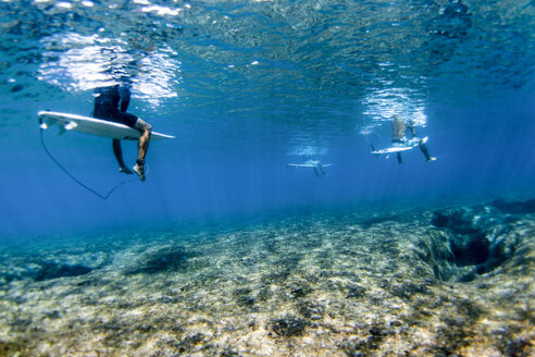 Underwater view of surfers above reef at Pipeline, on North Shore of Oahu, Hawaii, USA - AURF07385