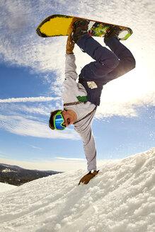 Snowboarder doing handplant trick, Vermont, USA - AURF07443