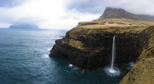 Scenery of famous Mulafossur waterfall, Gasadalur, Faroe Islands, Denmark - AURF07569