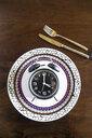 Intermittent fasting, trend 16:8 fasten, alarm clock on plate - SARF03934