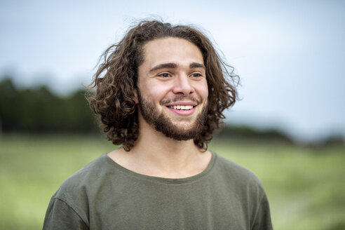 Portrait of happy young man outdoors - FMKF05245
