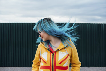 Young woman with blowing dyed blue hair - VPIF00847