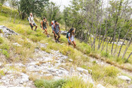 Italy, Massa, group of young people hiking in the Alpi Apuane mountains - WPEF00831