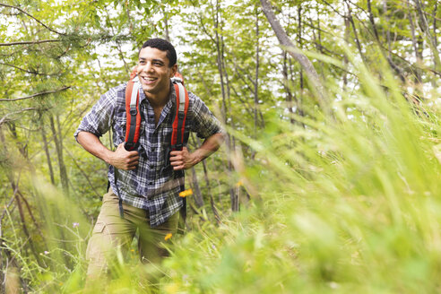 Italy, Massa, smiling young man hiking in the Alpi Apuane mountains - WPEF00843
