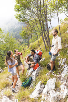 Italy, Massa, hikers taking a rest during a day in the Alpi Apuane mountains - WPEF00846