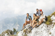 Italy, Massa, group of people hiking and looking at the view in the Alpi Apuane - WPEF00876