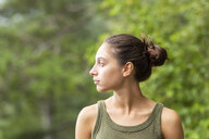 Portrait of young woman outdoors looking sideways - WPEF00894